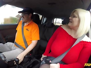 Lacey Starr is a big titted, blonde mature who likes to mad about men, even in the jalopy