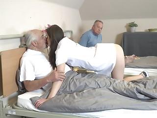 Young nurse Nana Garnet is sucking hard dicks of two pensioners