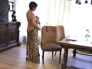 Matured lady makes leopard print dress look sexy with an increment of she masturbates many a time